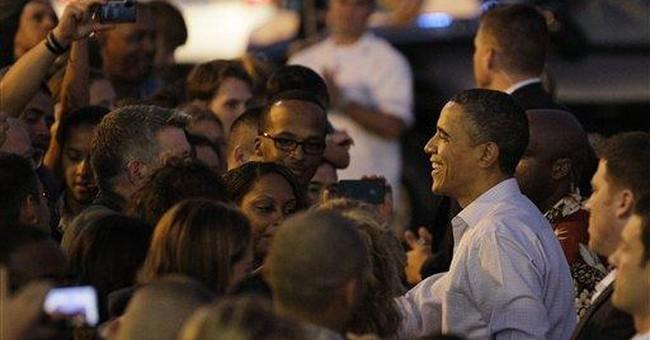 After a delay, Obama begins Hawaiian vacation