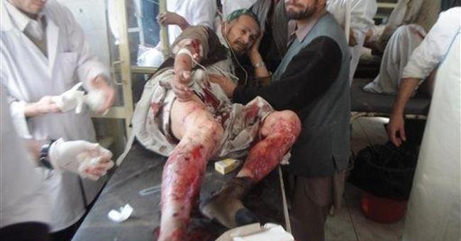 Suicide bomber strikes Afghan funeral, killing 19
