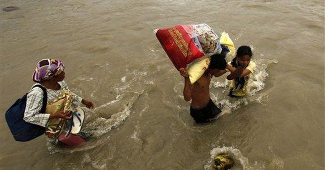 Philippine storm death toll goes down to 1,249