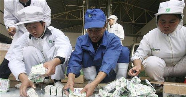China dairy producer says it destroys tainted milk