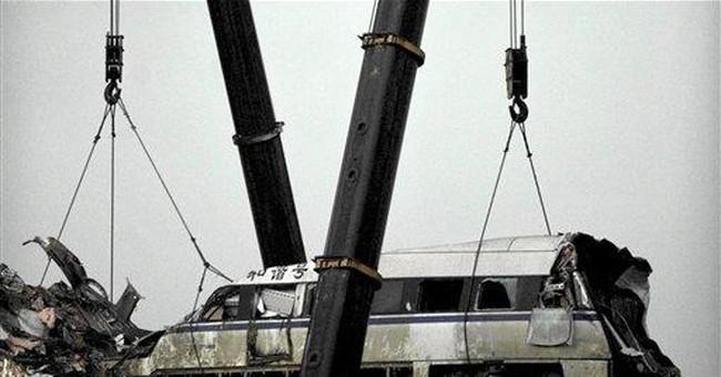 China blames 54 officials for bullet train crash