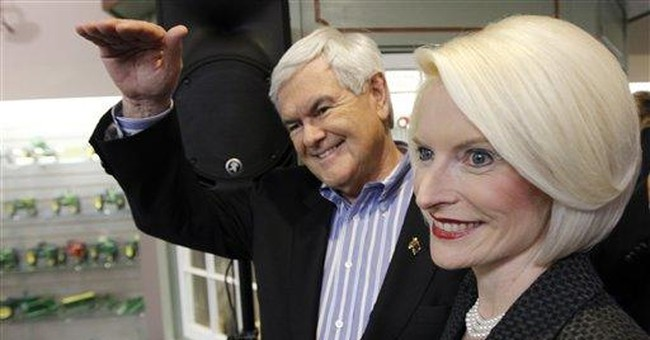 Gingrich sharpens attacks on Romney, Paul
