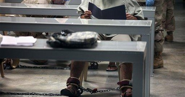 Guantanamo leader signs order opposed by lawyers