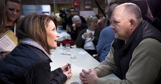 Bachmann loses Iowa campaign chairman to Paul