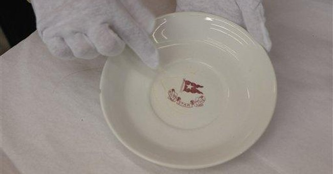 APNewsbreak: Titanic artifacts headed to auction