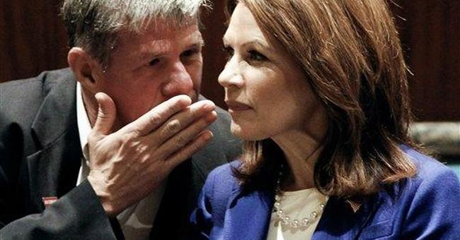 Bachmann vows to stay in GOP race despite setbacks