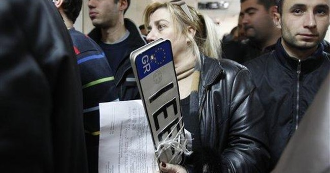 Greek tax officials on strike over salary cuts