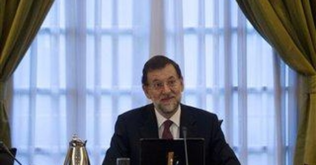 Spain revises up deficit and raises taxes