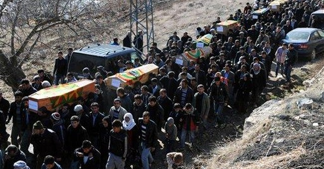 Turkey airstrike: mourners pummel local official