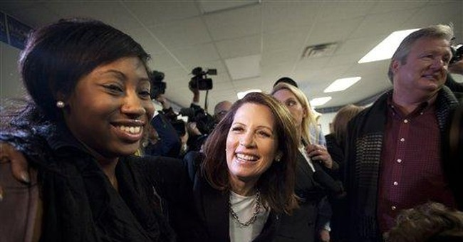 Bachmann plays gender card as Iowa GOP vote nears