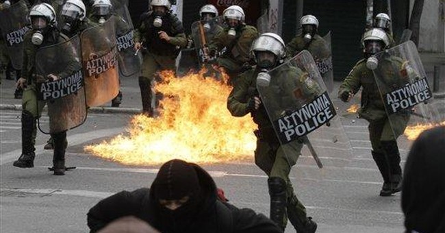 Greek riot police, protesters clash during strike