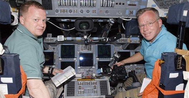 Astronauts sleep in after busy docking day