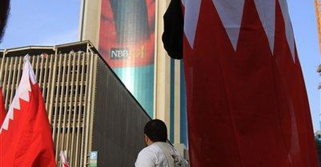 Bahrain ousts ministers as Shiite figure returns