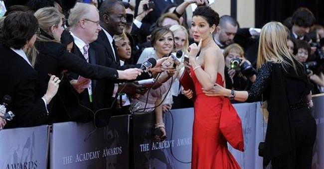 Sandra Bullock returns triumphant to Oscar stage