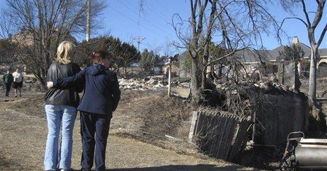 Stunned Texans find homes destroyed by wildfires