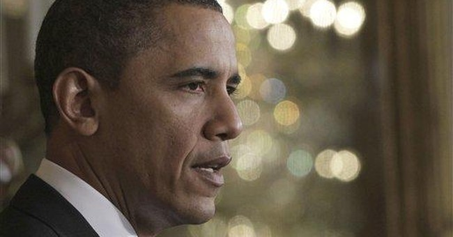Obama insists every option under review for Libya
