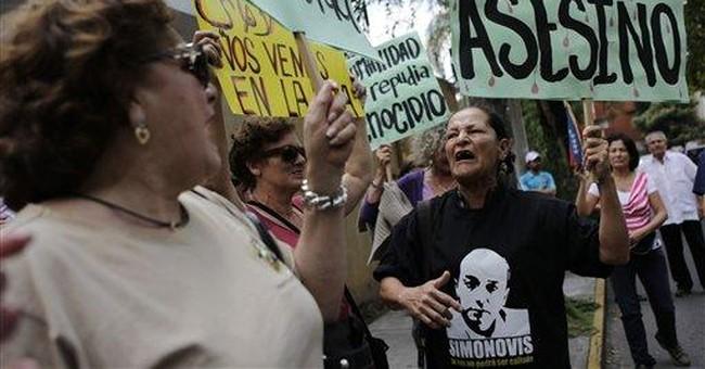 Venezuela: Gadhafi supports Chavez peace proposal