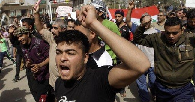 Iraqis defy checkpoints, vehicle bans to protest