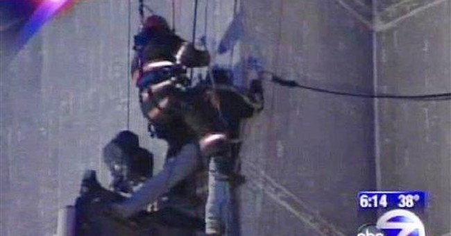 Rappelling NY firefighter rescues trapped workers