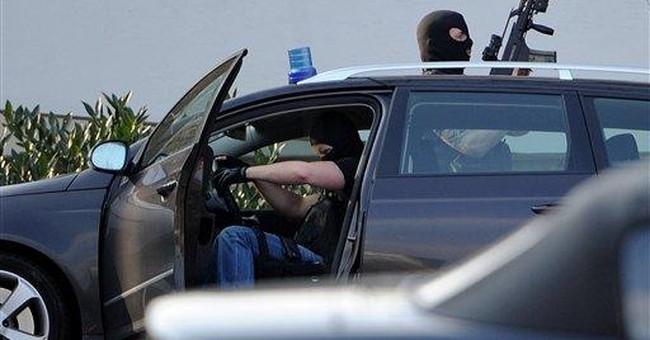 Attacker's gun jammed in Germany, sparing airman