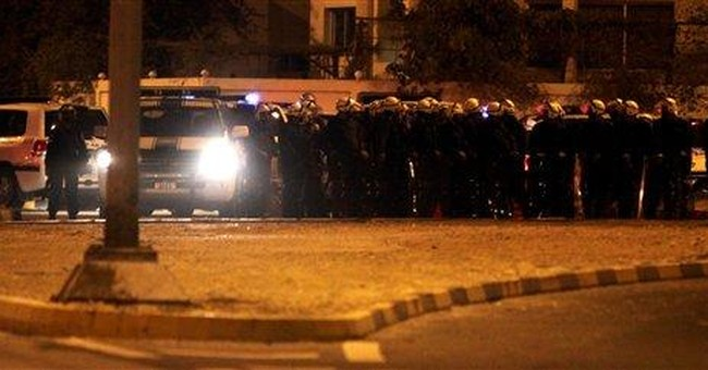 Bahraini protesters swarm state TV after clashes