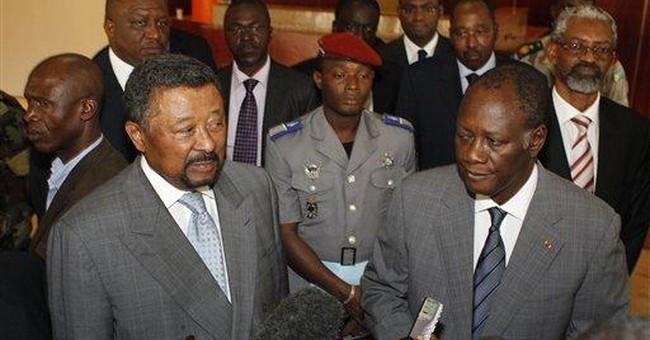 Ivory Coast's Ouattara to attend AU meeting