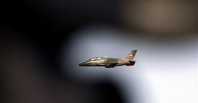Serbia, arms dealer to Libya, silent on rebellion