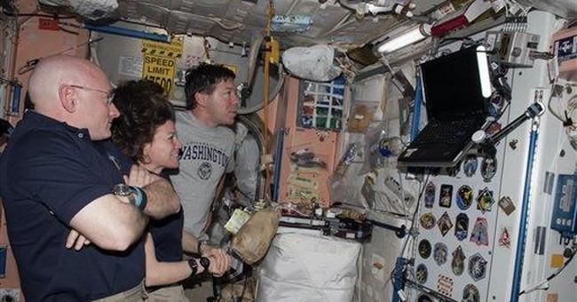 2 space crews mark 1 week together in orbit