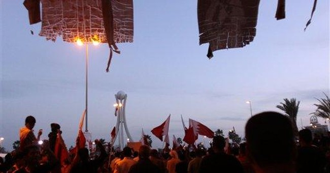 Shiite protesters in Bahrain encircle capital