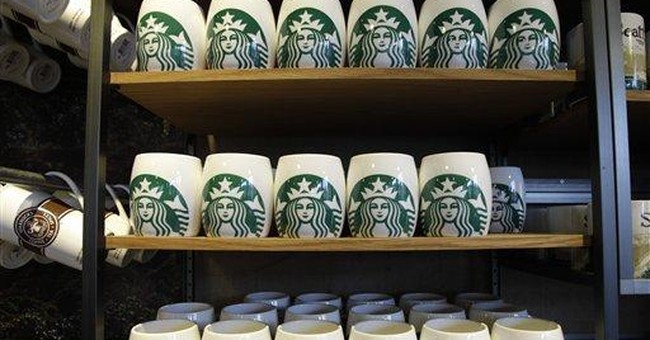 Starbucks' new logo debuts on cups, cafes
