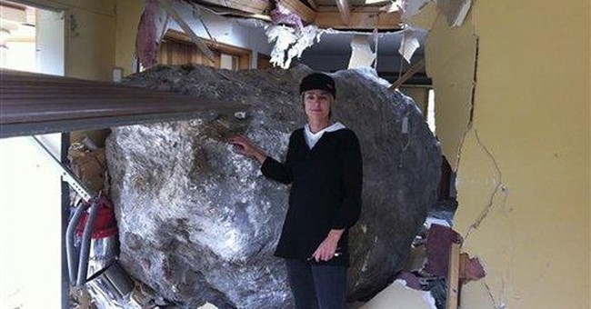 NZ man auctions boulder that smashed home in quake