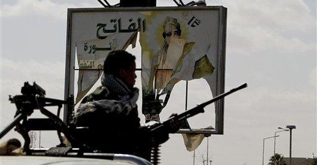 Uprising shatters Gadhafi image of absolute power