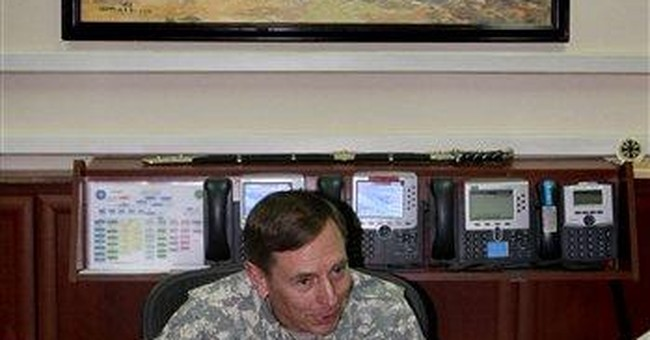 AP Interview: Petraeus says tough summer ahead