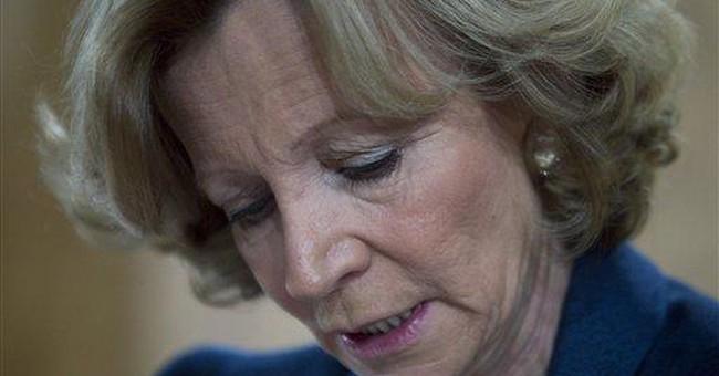 Spain hit by Moody's debt downgrade