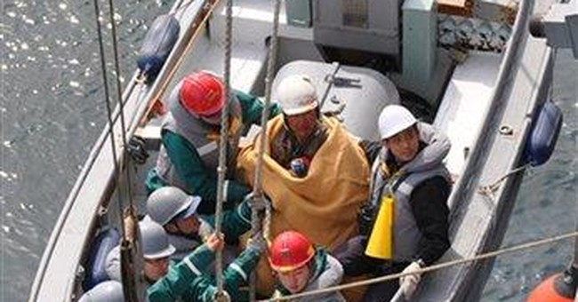 Japan man saved from rooftop that floated to sea