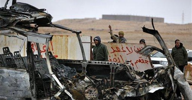 Gadhafi forces drive rebels from key oil town