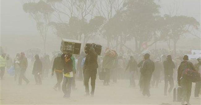 Migrant workers fleeing Libya vow not to return