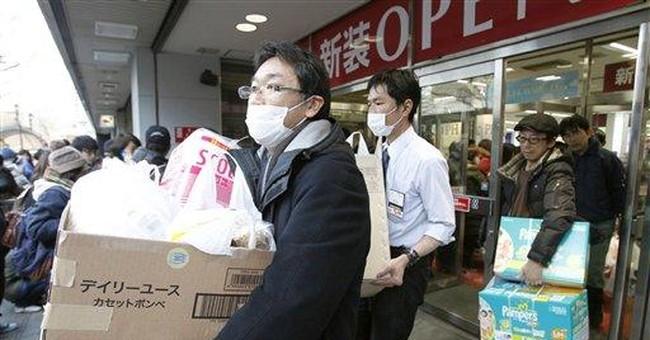 Japan central bank feeds markets money after quake