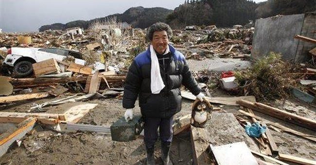 Hope and loss in Japan's search for 8,000 missing
