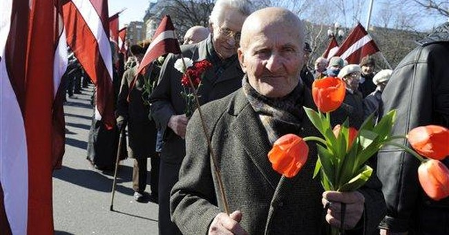 Latvians honor Waffen SS fighters