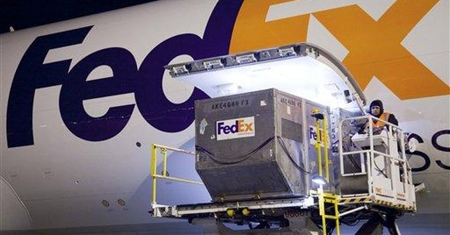 FedEx gives positive 4Q outlook, shares jump