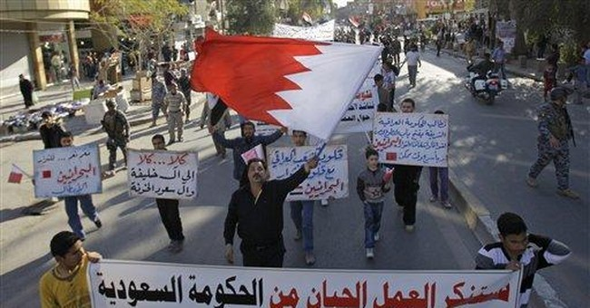 Iraqis eyeing Bahrain protests with anger, caution