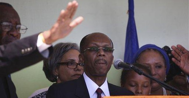 Warm welcome greets Aristide on return to Haiti