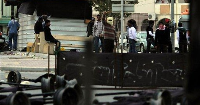 Bahrain crackdown widens; dissent comes from roofs