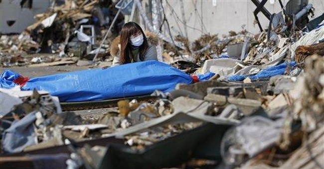 Japanese search the rubble for dead before cleanup