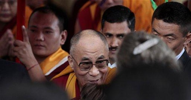 Dalai Lama says he's firm in decision to resign