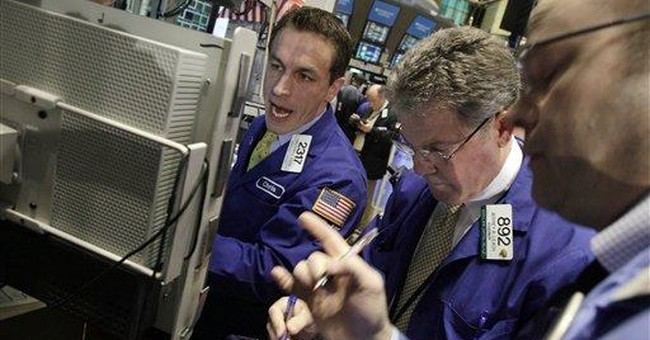 Deals help push the Dow back above 12,000