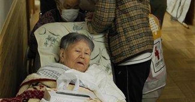 Japan tsunami survivors face long wait to go home