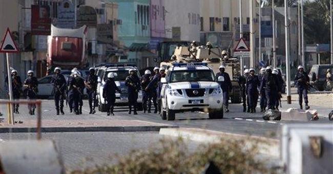 Bahrain king makes veiled charge against Iran