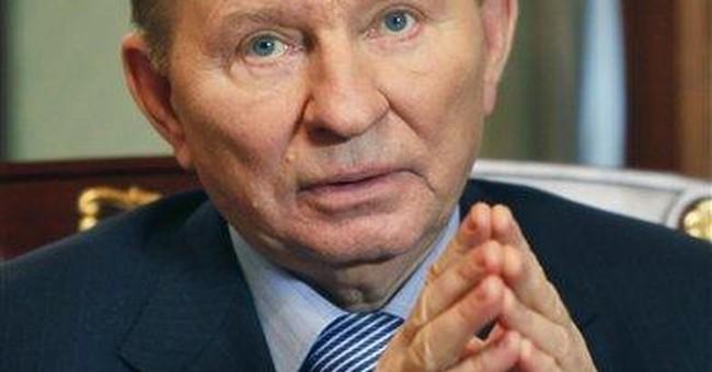Ex-Ukraine leader denies role in reporter's death